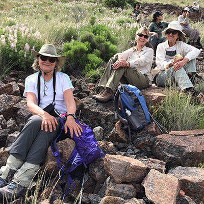 Women sitting on rocks resting while on a hike