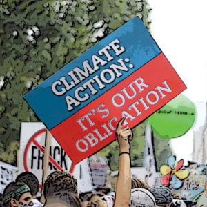 """A rally sign, """"Climate Action: Its our obligation""""."""