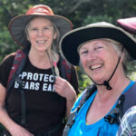 Two ladies in hats smiling