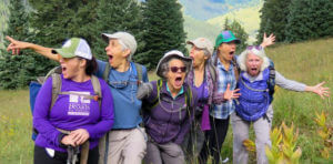 Women excited standing on a mountain hillside
