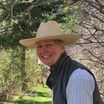 Woman in a cowboy hat smiling