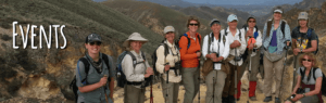 A group of Broads women wearing hiking gear standing in front of scenic view